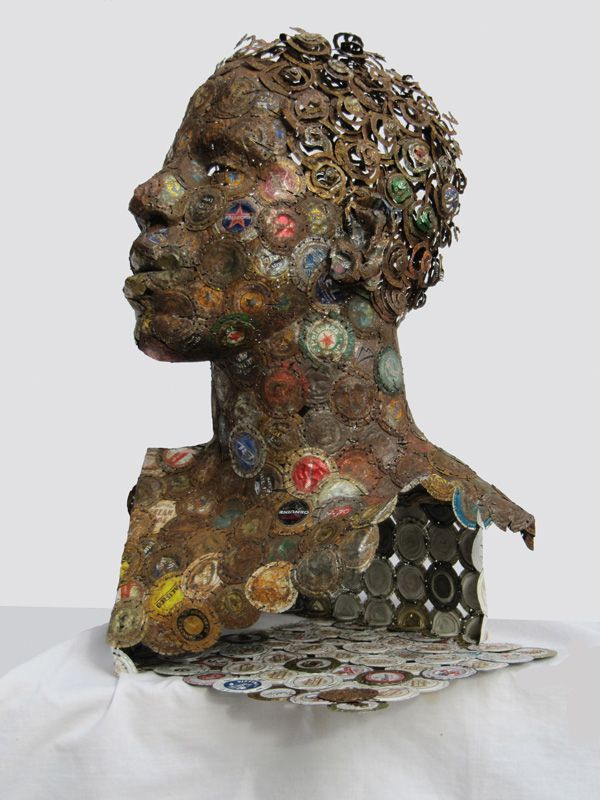 Assemblage art made from bottle caps. Sculpture by AM Fuller.