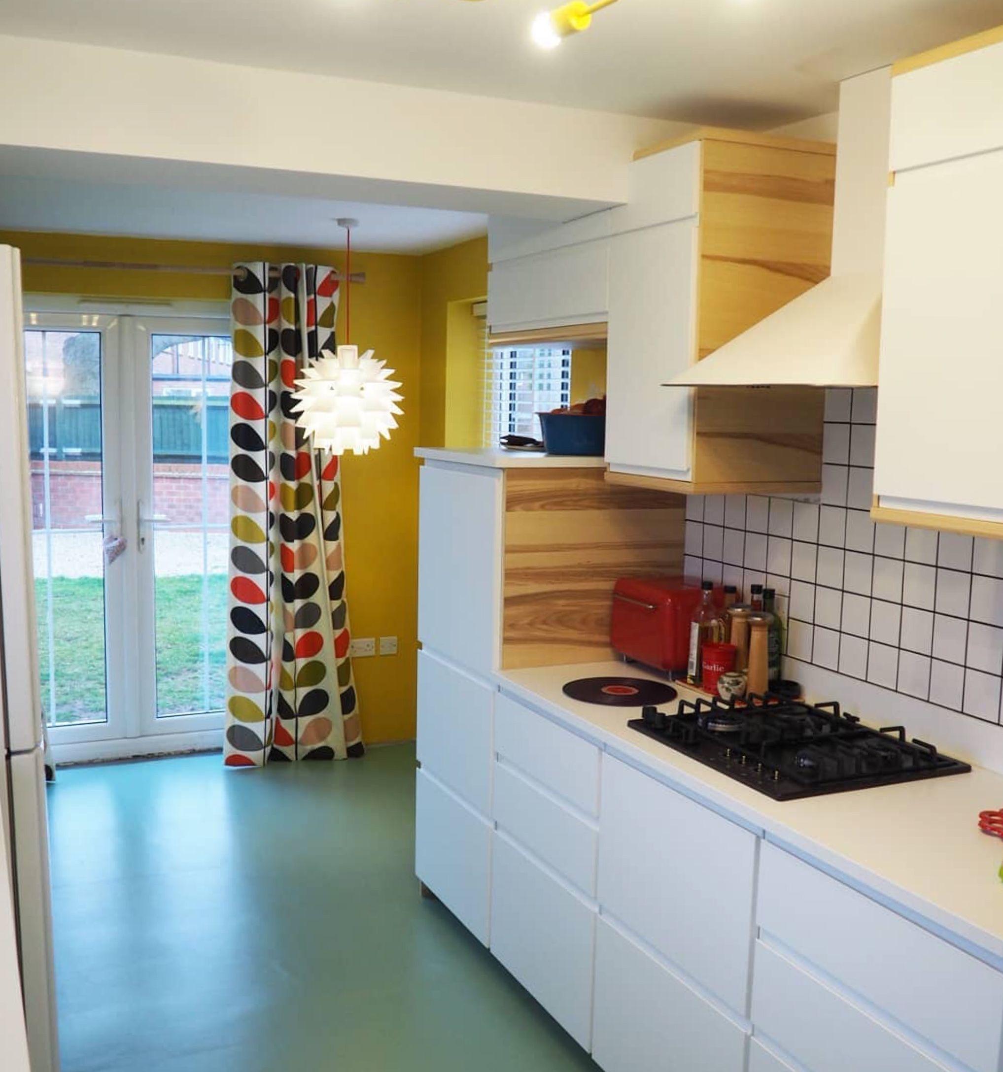 Restful Sage Green Vinyl Looks Great Against The White Kitchen