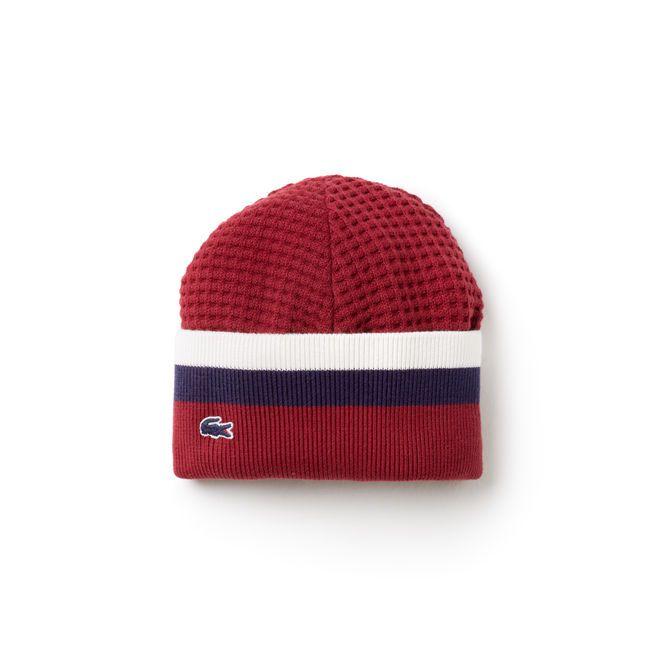 95e54374e6ae ... bonnet Lacoste fabriqué en France et confectionné en 100% coton. Maille  en relief, palette tricolore et crocodile iconique, portez-le avec son  écharpe ...