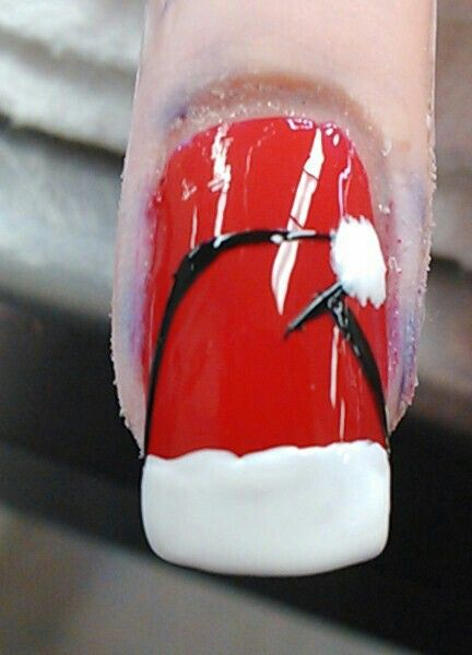 My Santa hat on top of my red painted acrylic nail