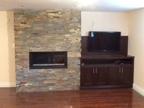 Modern Stone Fireplaces with built in shelves | ... stone work and cabinet surrounding Marquis Infinite Linear Fireplace