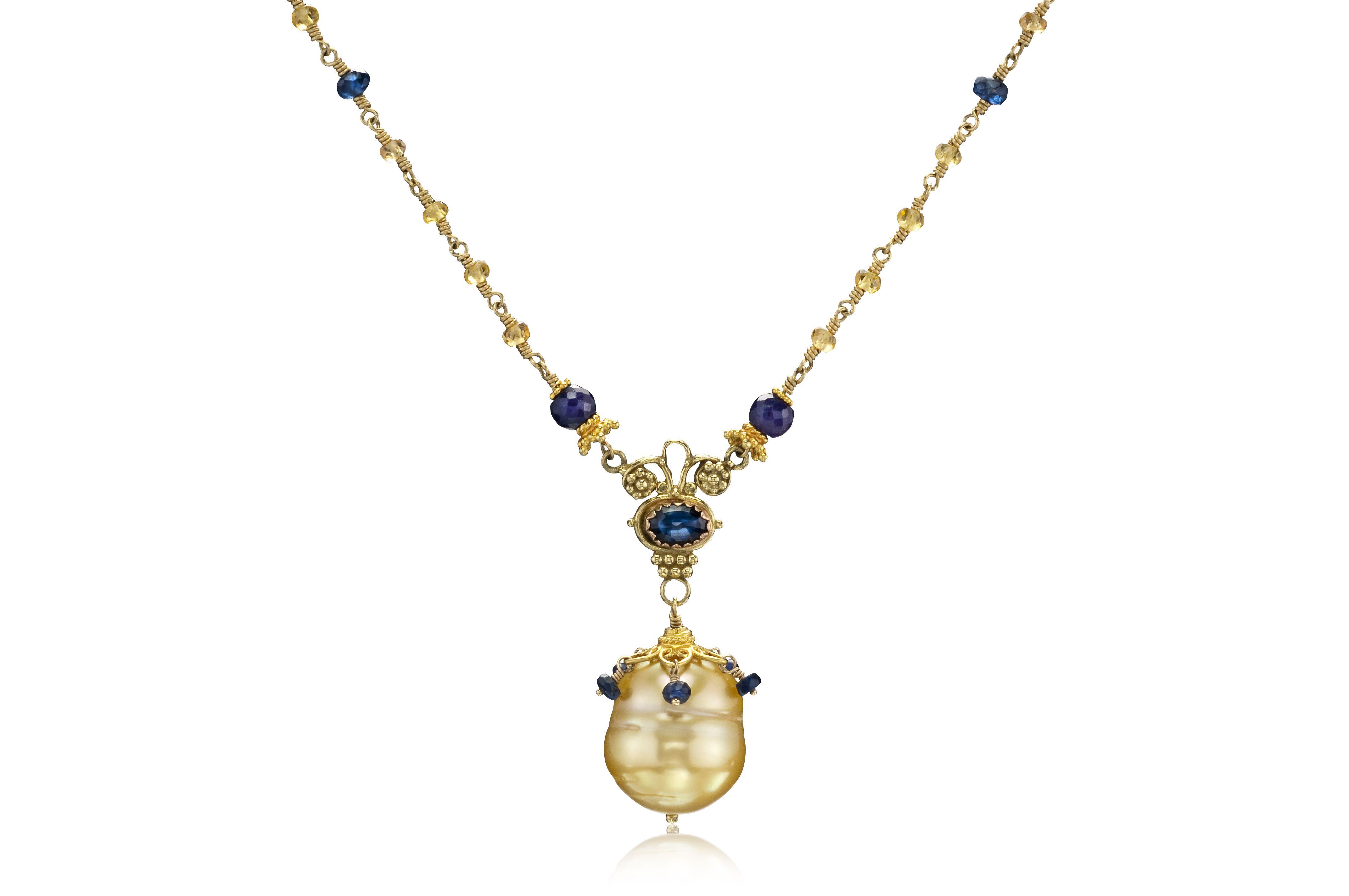 Photo of Goldene Südseeperle und gelb-blaue Saphir-Halskette aus 18 Karat Gold