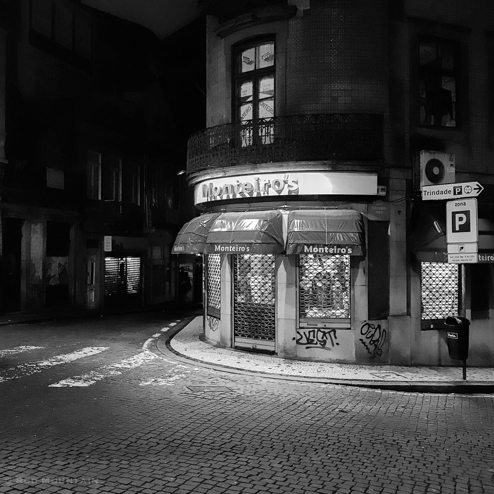 Porto, Portugal - Shops are all closed for the evening…  Image: © Rod Mountain  #iphoneography #shotoniphone #noirstreetlife  #insta #bnw_life #bnw_city #bnwmood #bnw_planet #mystery_bnw #bnw_addicted  #bnw_europe #stayandwander #igtravel #travels #xposuremag #photographylover #nighttravel #streetnight #noircity #nightshooters #nightlights #nightwalk #N8ZINE #bwstylesgf #bnw_captures  #bwmasters #streetshared #illgramers#way2ill #streetdreamsmag