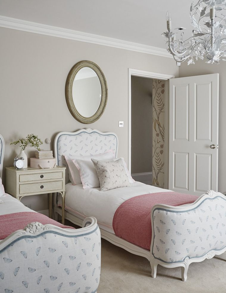 Delicate guest twin bedroom with elegant bed frames and