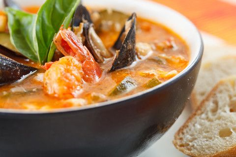 Enjoy a steamy bowl of flavorful seafood and shellfish over crunchy Italian bread.