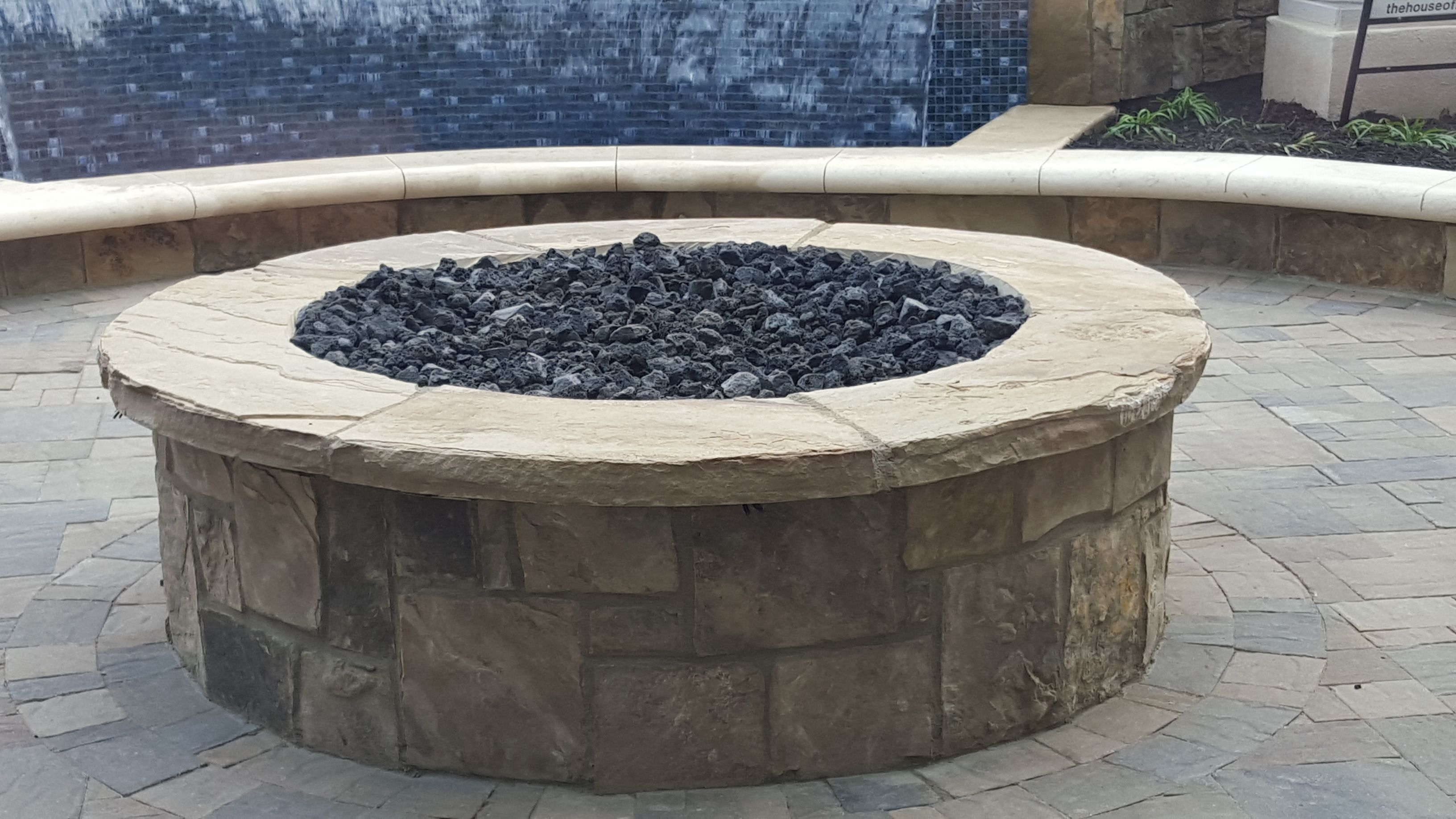 Our Pecos Tan Veneer Stone in an outdoor gas firepit ... on Rock And Stone Outdoor Living id=36918