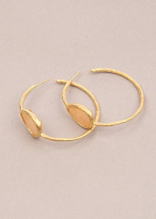 """Bold is better.. hammered gold hoop earrings accented with a single turquoise stone makes a style statement. Measure 2"""" in diameter. Stone is 1/2 inch in diameter. $36.00"""