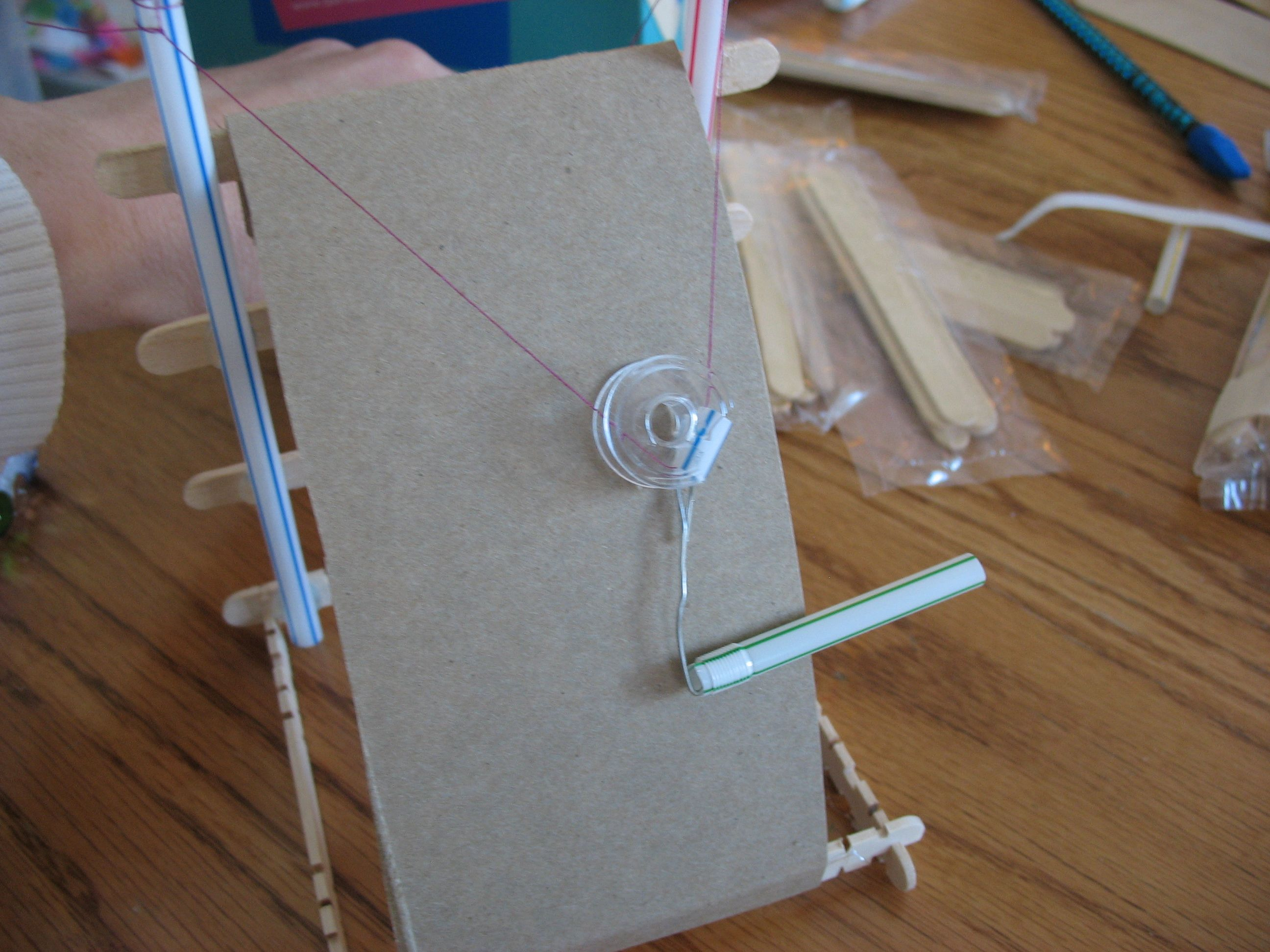 Pulley Using Empty Tape Roll Straws And Cardboard