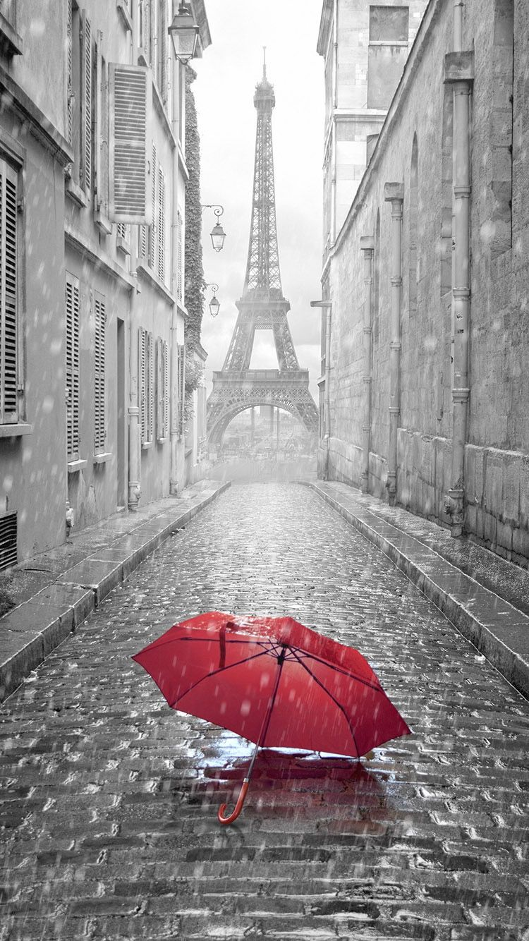 TAP AND GET FREE APP Red Umbrella In Eiffel Tower Background