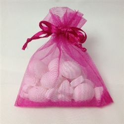 Plain coloured organza bag filled with imperial mints and heart shaped mints