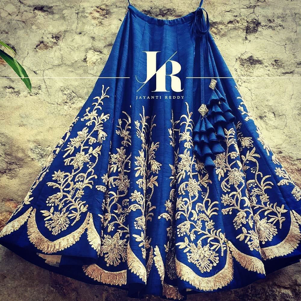 Stunning blue color designer lehenga with rich embroidery work from Jayanti Reddy.