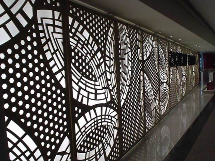 Round Aluminium Panel : A wall is made of black powder coated aluminum perforated