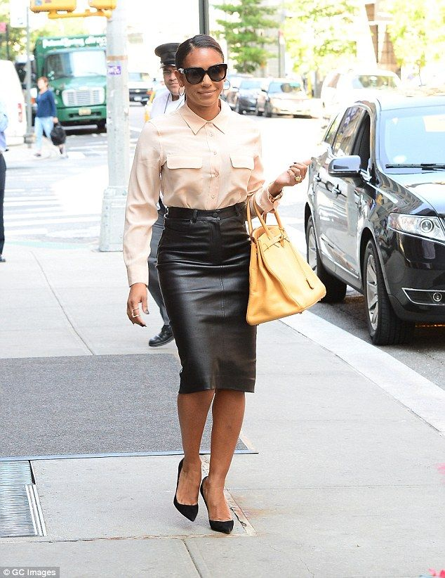 Mel B looks effortlessly chic in cream blouse and leather pencil ...