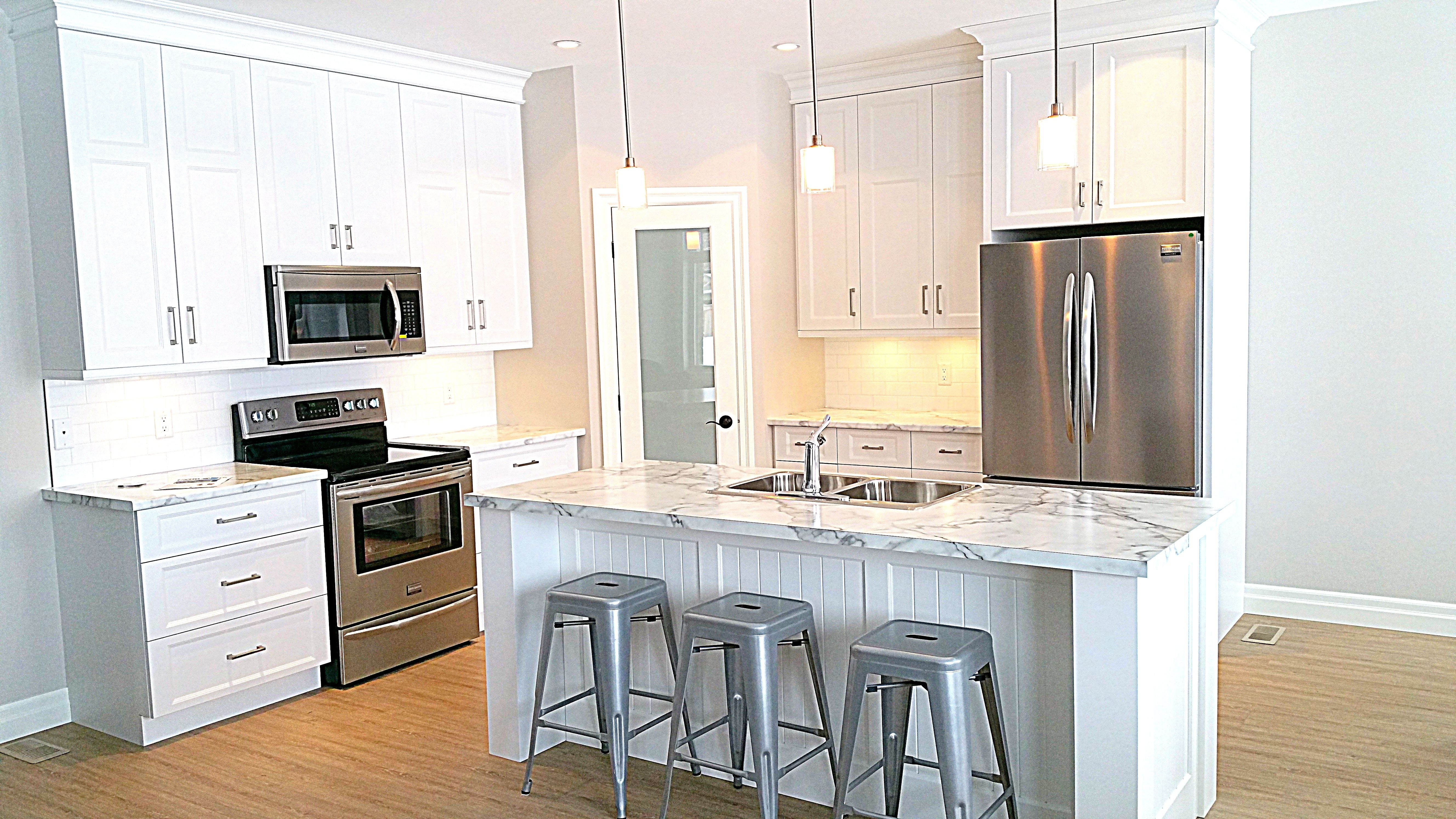 Clean bright airy kitchen formica x countertop with white
