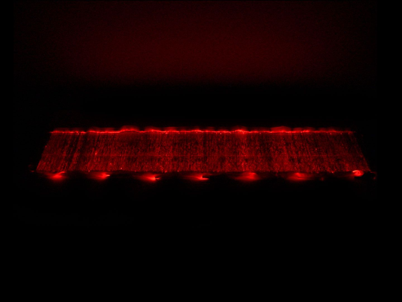 Fiber Optic Table Runner cloth glowing red, full length