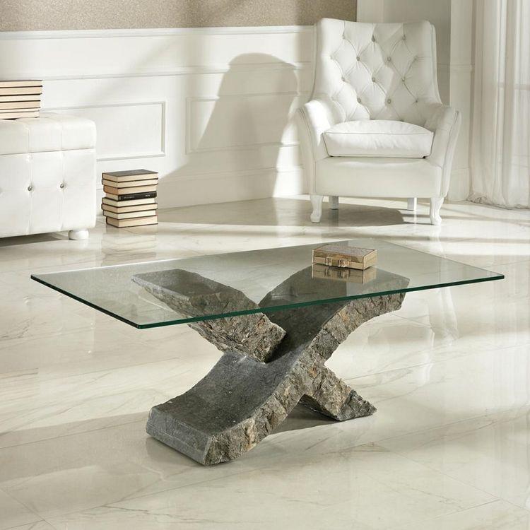 table basse en verre avec pied en pierre fossilisée en forme de x