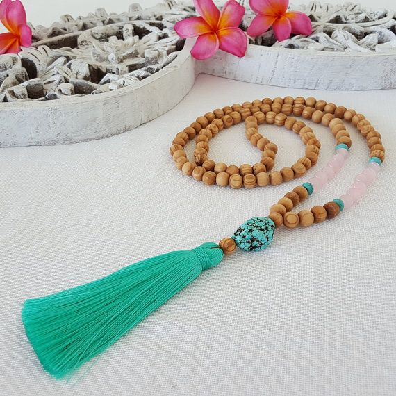 Wood bead and rose quartz tassel necklace with turquoise feature bead and a teal tassel