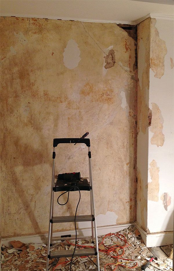 mn - study / wall (during) : old painted-over wallpaper peeling away from plaster . cracks ...