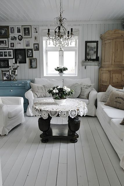 Gorgeous white wash room. Love the vintage details.