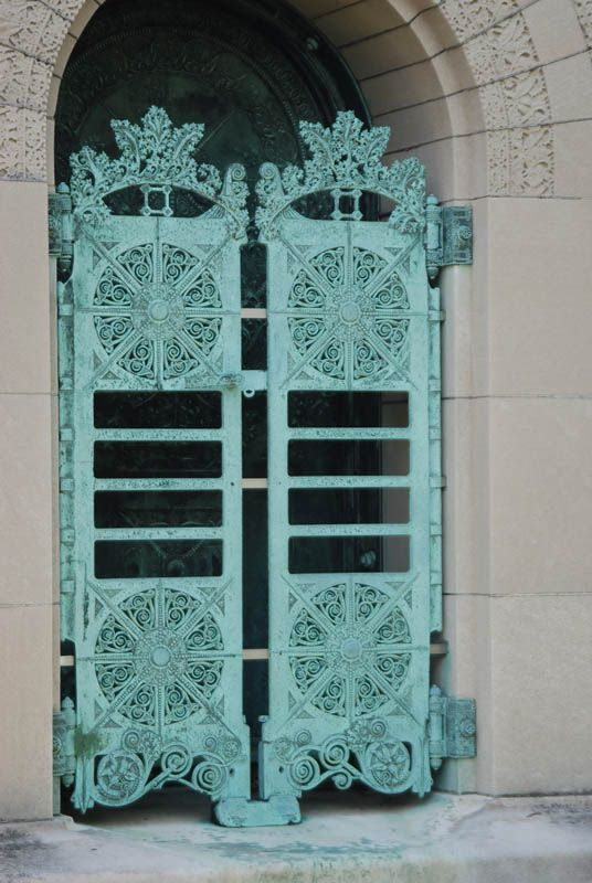 ornate carved turquoise doors.