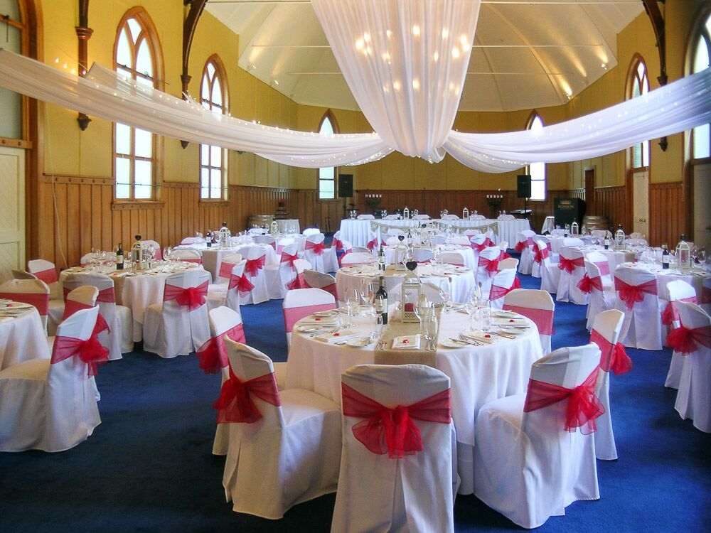 Wedding of Casey and Jason, Mission Estate, April 2015 - Red and Gold, natural hessian runners, classic white lantern with red candles, red chair sashes give a pop of colour in the room, circular canopy with fairy lights.