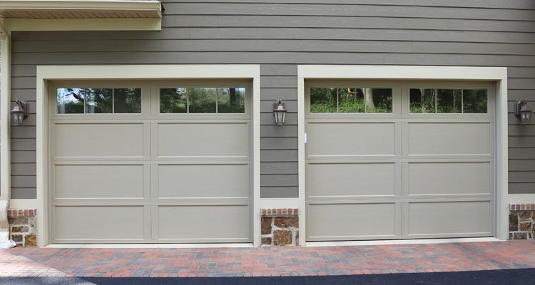 This Custom Home Features Overhead Door Carriage House Collection Garage Doors Installed By Overhead Door Company Of Wa Garage Doors Garage Doors Prices House