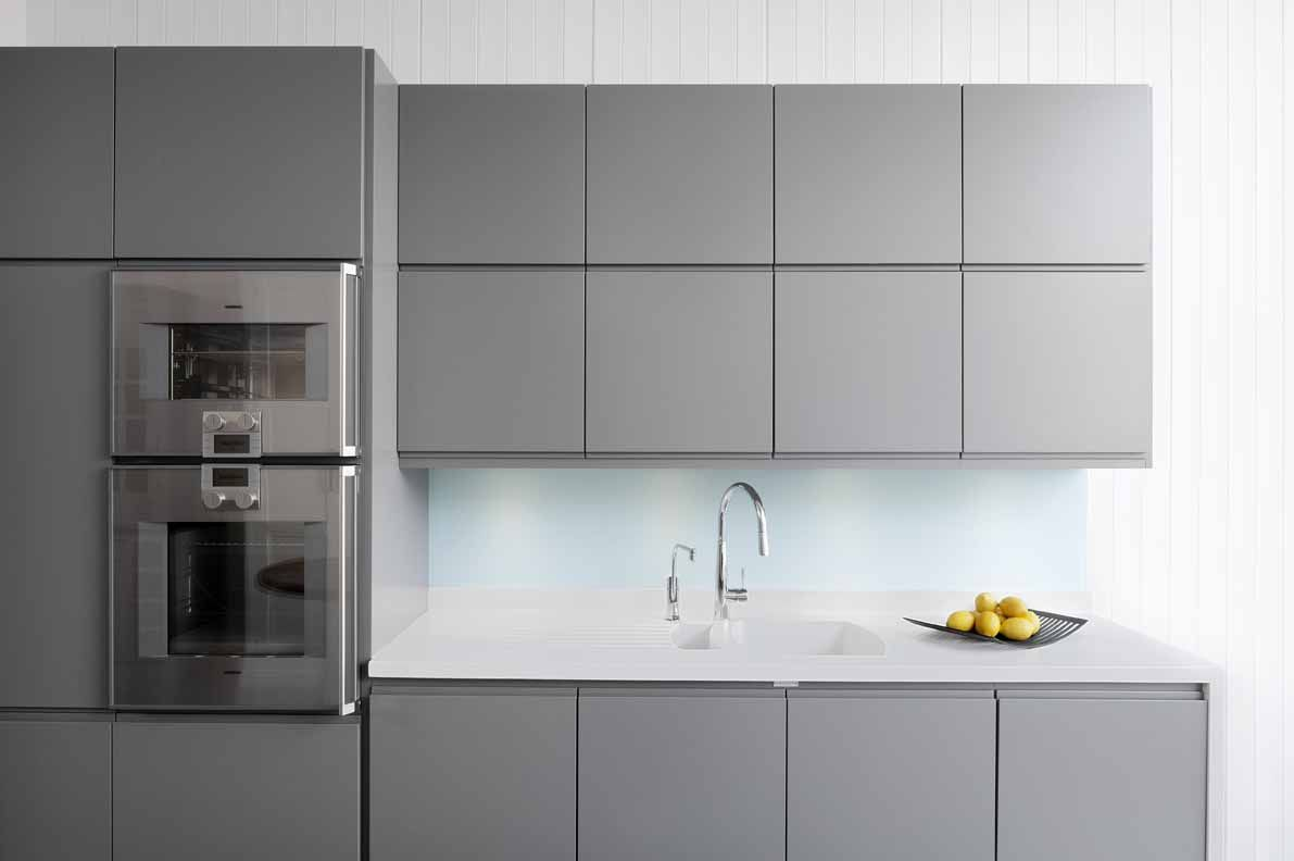 sola sletten in grey with white corian worktop kitchen. Black Bedroom Furniture Sets. Home Design Ideas