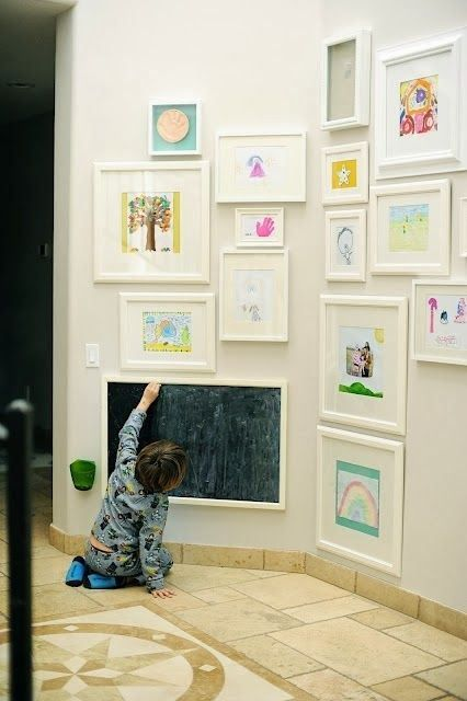 Kid art in frames. This would be especially great in a family room or hallway.