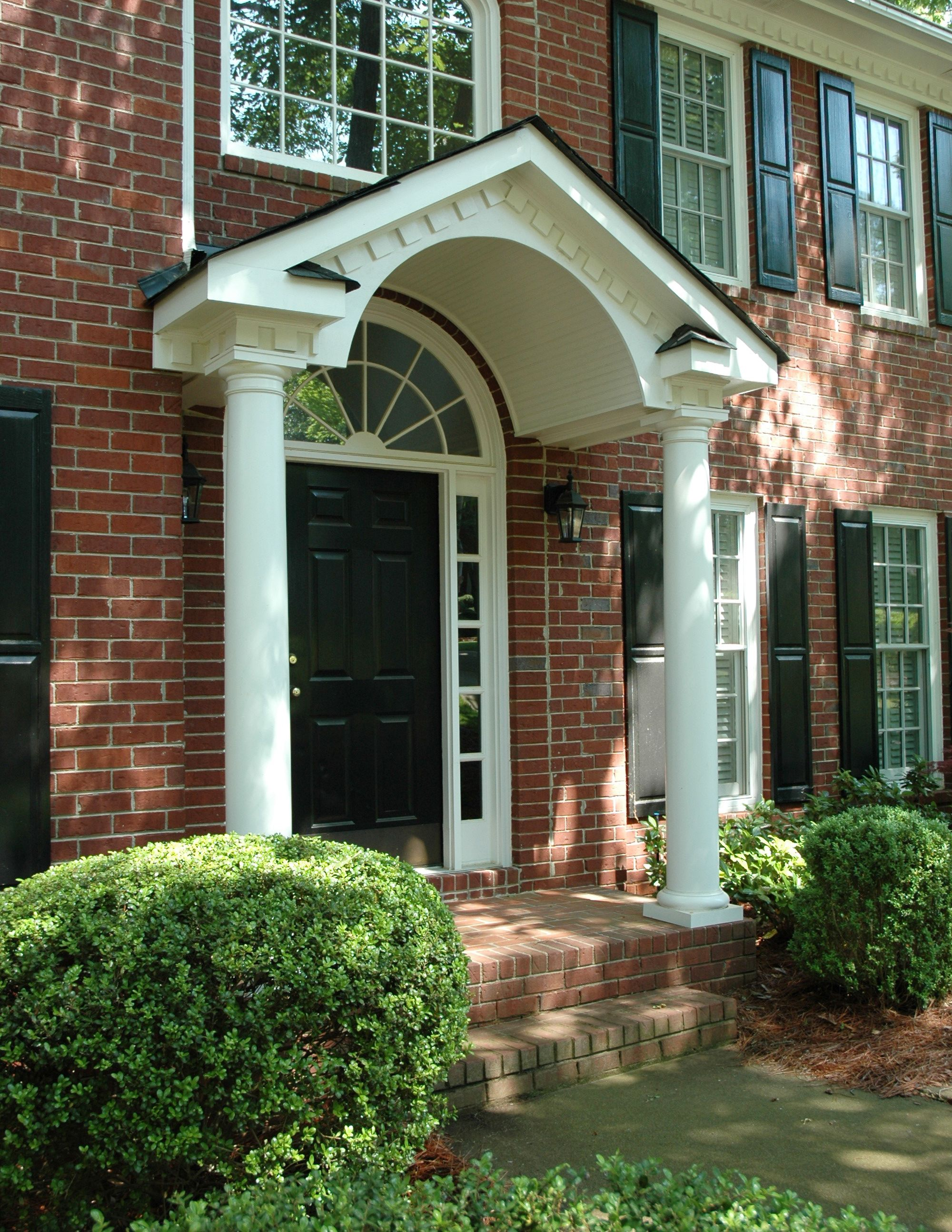 Gabled portico with arched beadboard ceiling designed by for Georgia front porch