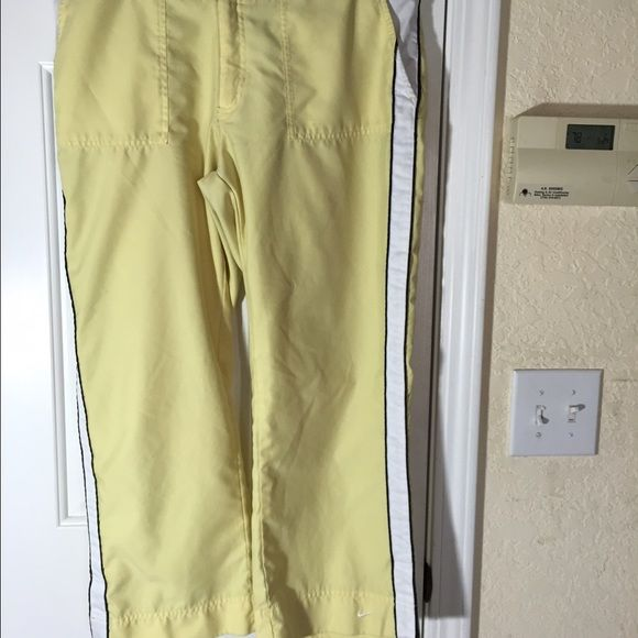 495ea56dc236 Nike work out pants Canary yellow with white   navy stripe down the side.  Size 12-14