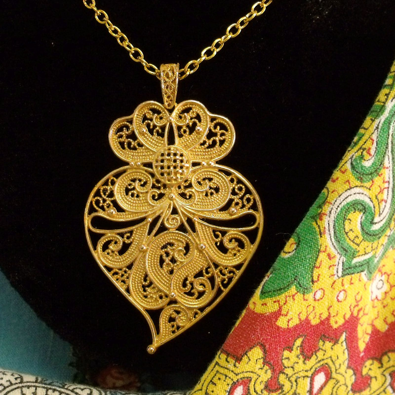 Portuguese folk big filigree Heart of Viana style pendant chain necklace. Inspired in the Portugal traditional filigree jewelry used by country women in the north of Portugal. $39.00...#madeinPortugal#portugaljewelry#vianaheart#portuguesefiligree#portugalfolkart#portuguesenecklace#coraçãodeviana#helenaaleixo