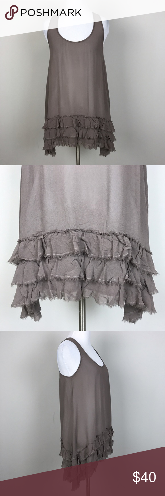"[Anthropologie] Silk Ruffle Trapeze Tunic Top Chic Sleeveless scoop neck Tunic tank. Sheer 100% silk with ruffled layer hem. Draped longer on the sides. A great layering piece. By Odille from Anthropologie.  🔹Pit to Pit: 15""  🔹Length: 28"" - 32"" 🔹Condition: Excellent pre-owned condition.  *WW43 Anthropologie Tops Tunics"