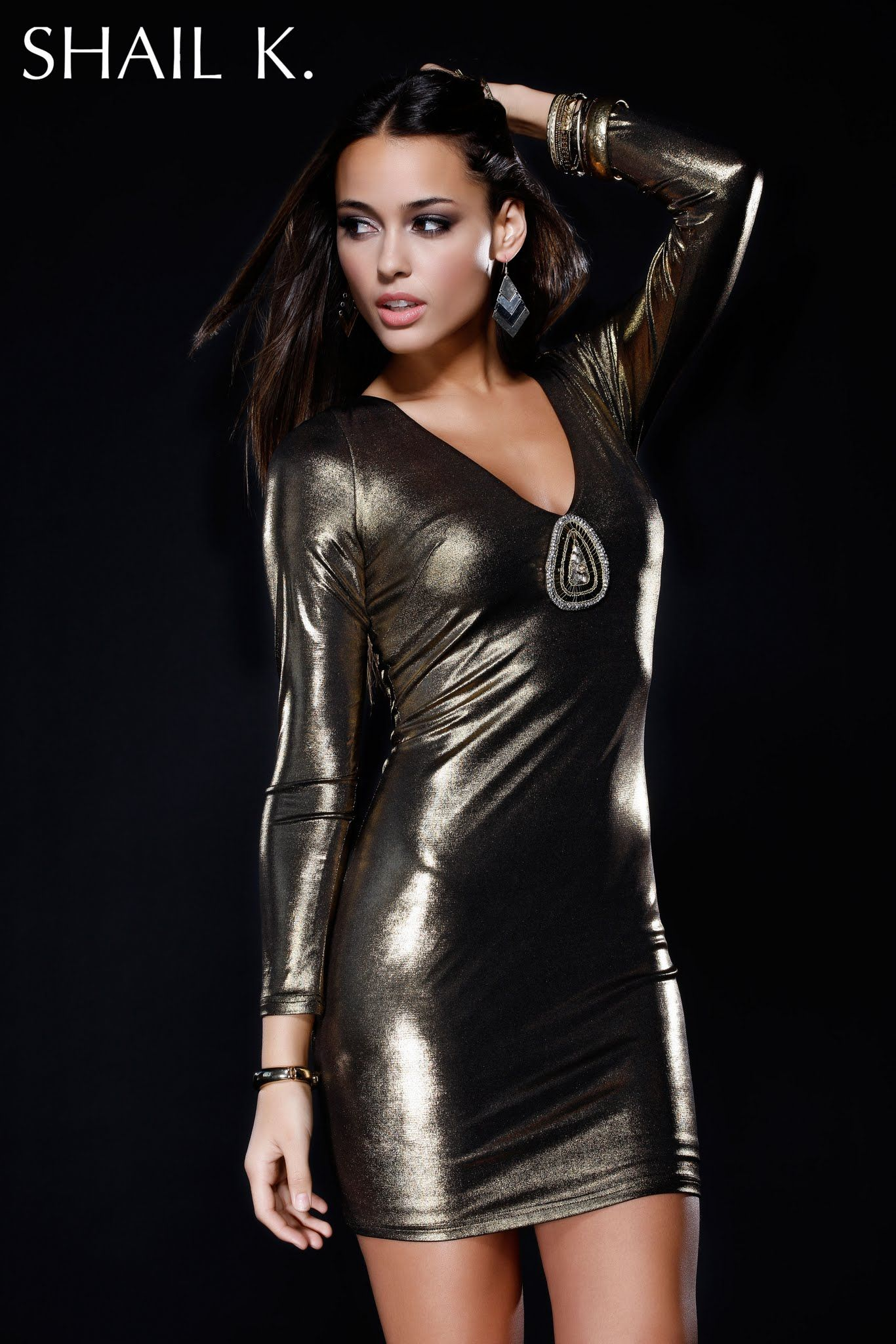 Look like a rockstar in this sexy-sleek Metallic Gold style. Featuring an embroidery patch at the bust which sparkles beautifully!    Visit us @ www.shailkusa.com