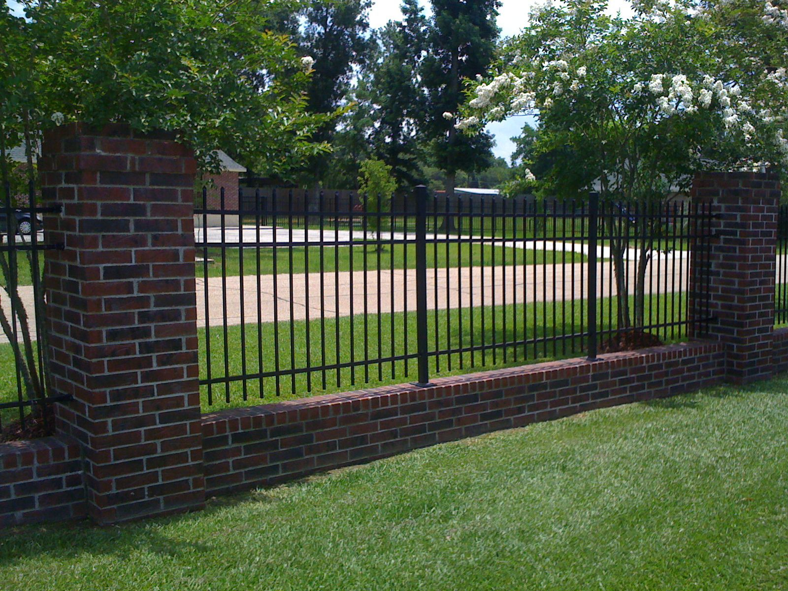 Wrought Iron Fencing With Brick Border Backyard Fences Fence Design Brick Fence