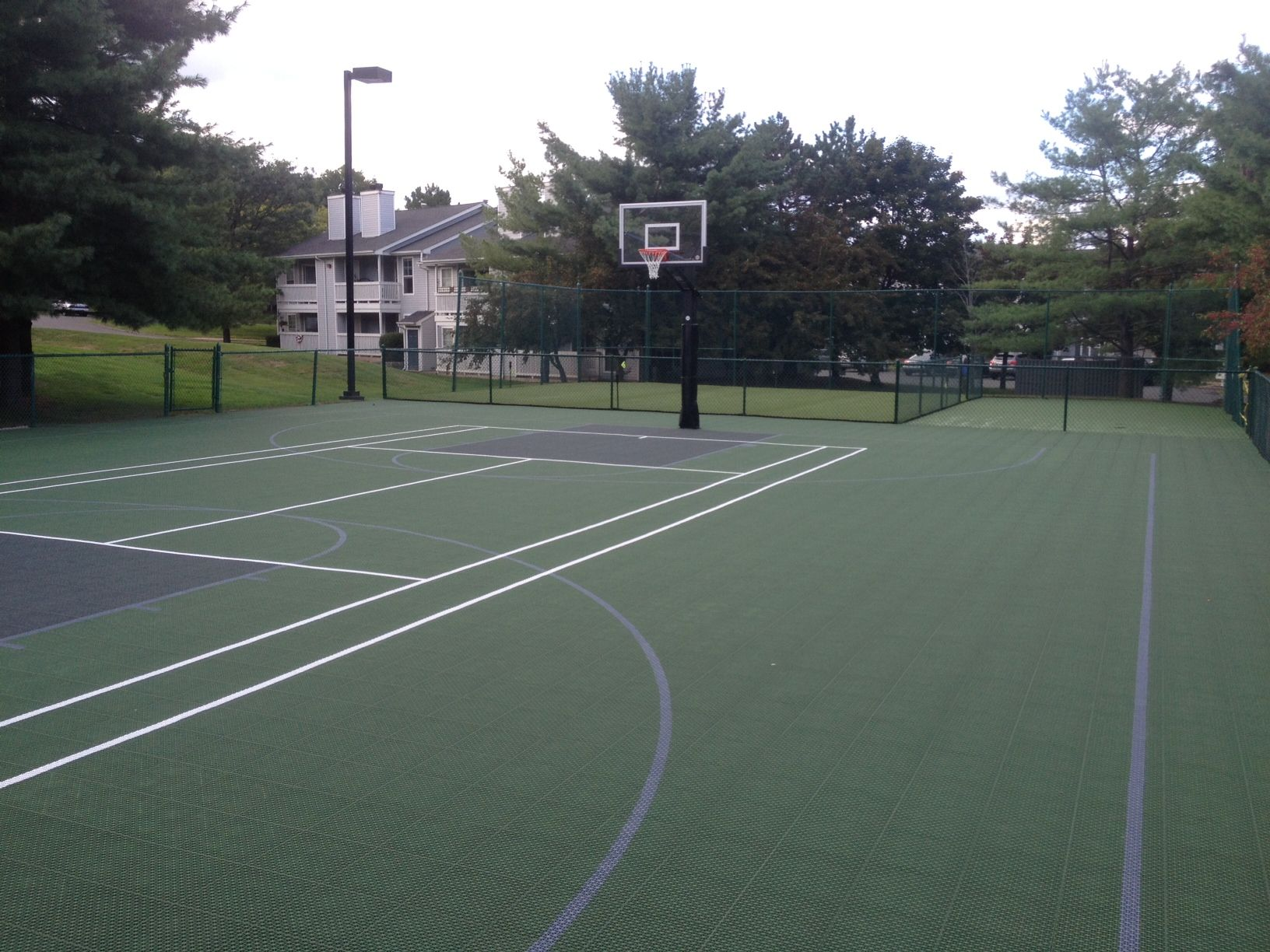 Full tennis court at an apartment complex converted into a for Cheapest way to make a basketball court