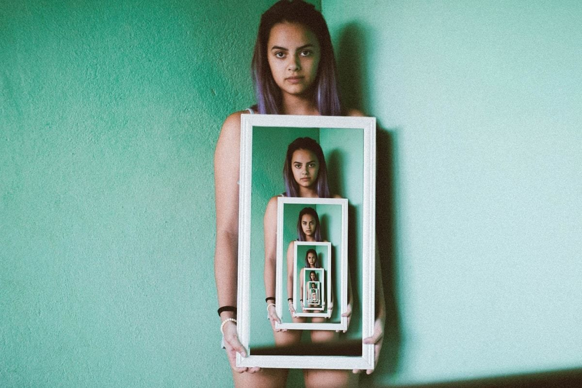 Girl holding a neverending photo of herself. Best photo