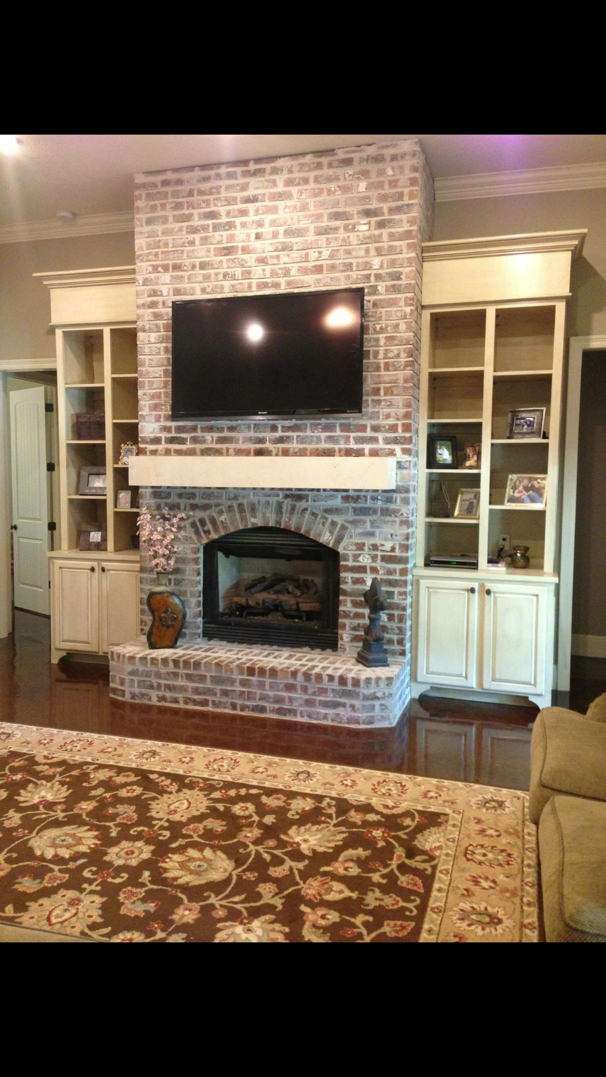 Brick fireplace with side shelving leaving room Pinterest