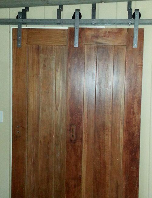 The Double Track Bypass Barn Door Hardware System Includes 2 Hanger Sets 4 Hangers Total Suita Bypass Barn Door Hardware Barn Door Hardware Bypass Barn Door