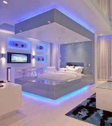 Una moderna e rilassante camera da letto illuminata da for Camera da letto luci
