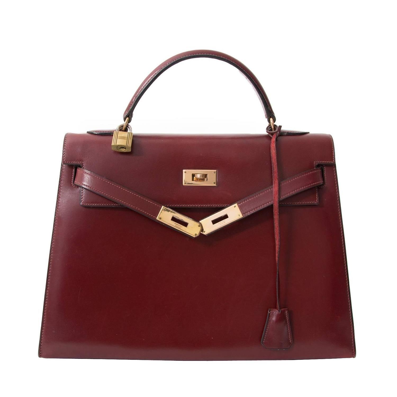 Hermès Kelly Box Calf Rouge Hermès in 2019   All About the BAG ... 434f20c50d2