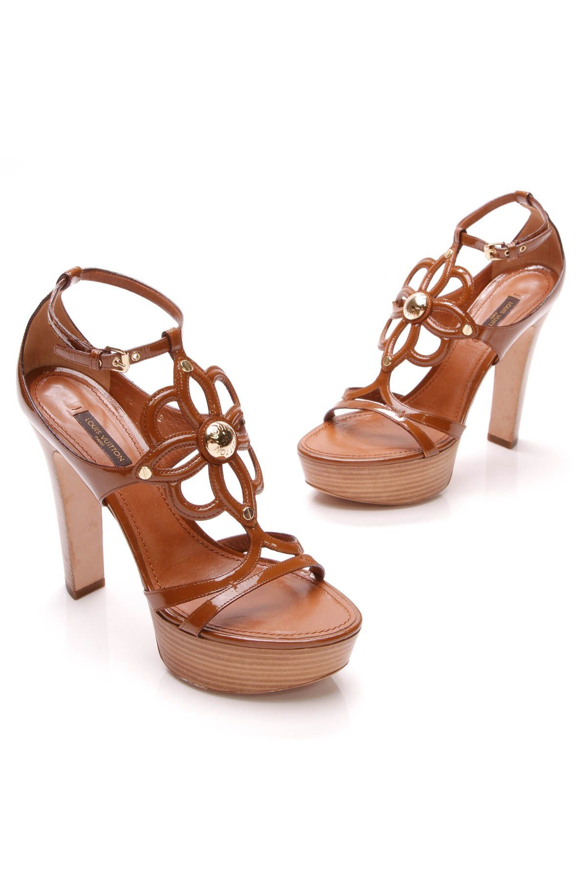 845dfe23f14 Louis Vuitton brown gloss platform sandals with flower detail are the IT summer  sandal heel!