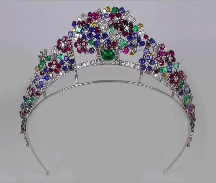 1937 Tiara, made by Cartier France: rubies, emeralds, sapphires, and diamonds. Via http://dinastias.forogratis.es/.