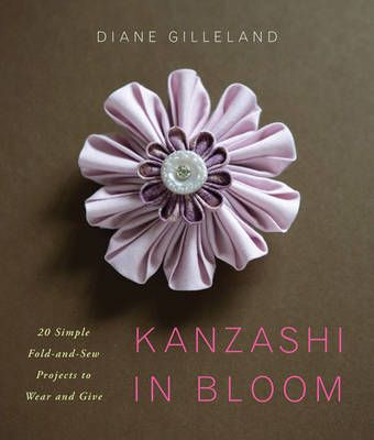 Kanzashi Tsumami is the Japanese art of folding delicate squares of silk into dimensional flower petals.