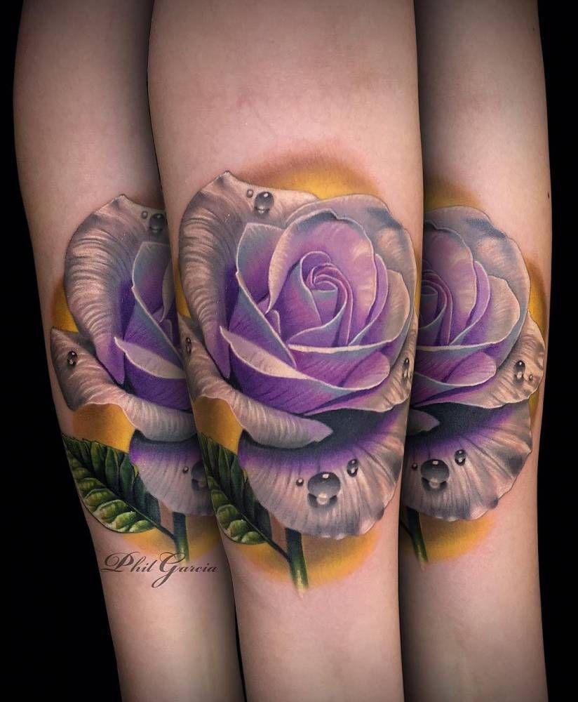 Realistic Purple Rose Tattoo On The Left Inner Arm Tattoo Artist