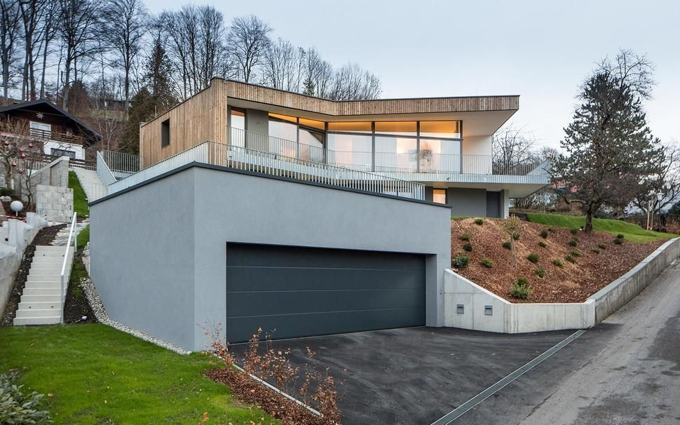 3 Storey Home On Steep Slope With Grass Roofed Garage Hillside