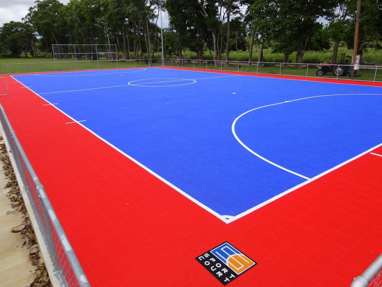 Sport court power game bright blue and bright red futsal for Sport court ideas