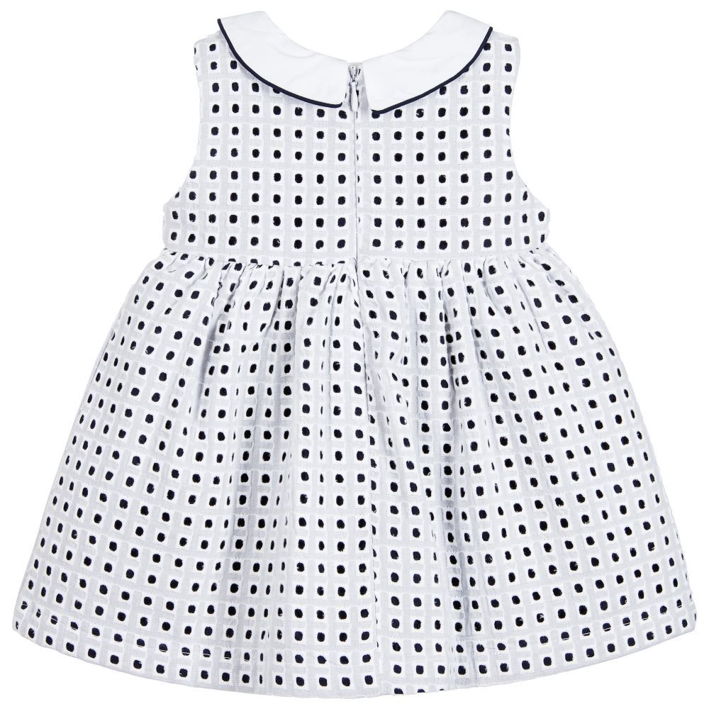 eb4aed98489e Girls white and navy blue dress by Mayoral Chic. It is made from cotton with