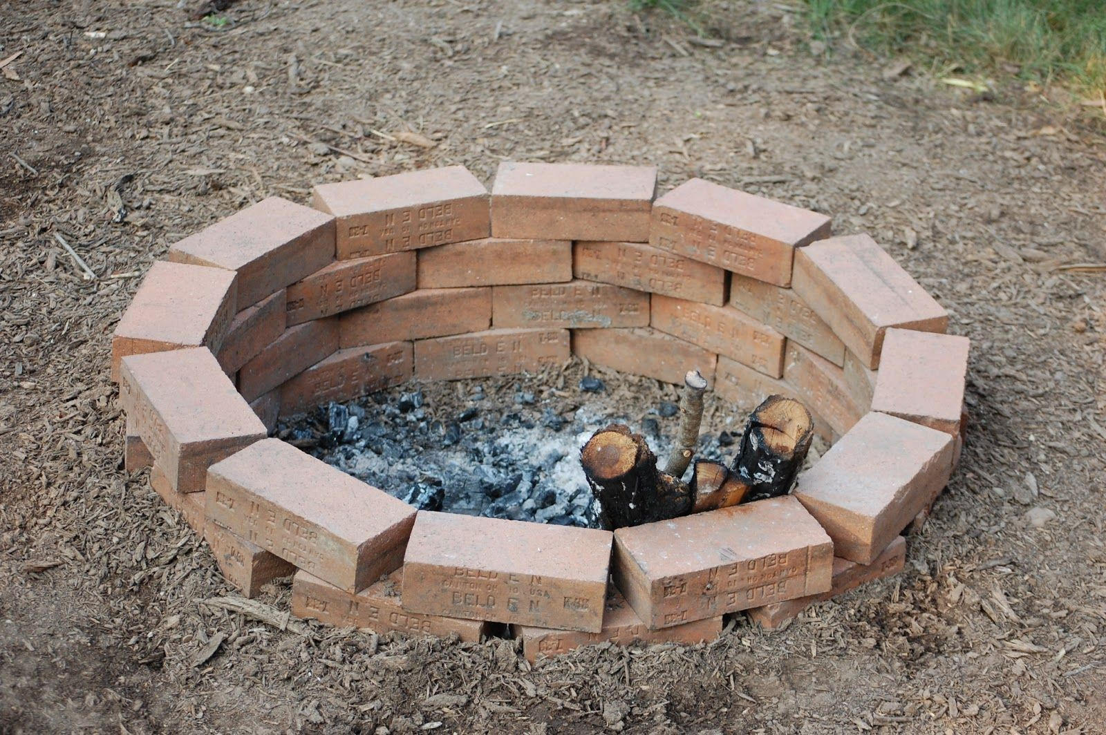 Sweet a simple fire pit using bricks because fire rated ...