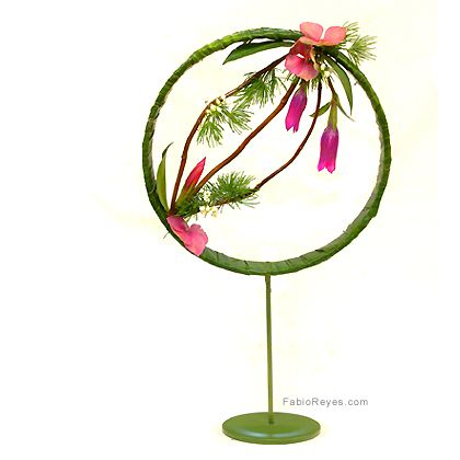 cool armature piece. we can mix fabric and floral. $75.00-$100.00 depending on flower types and how full.