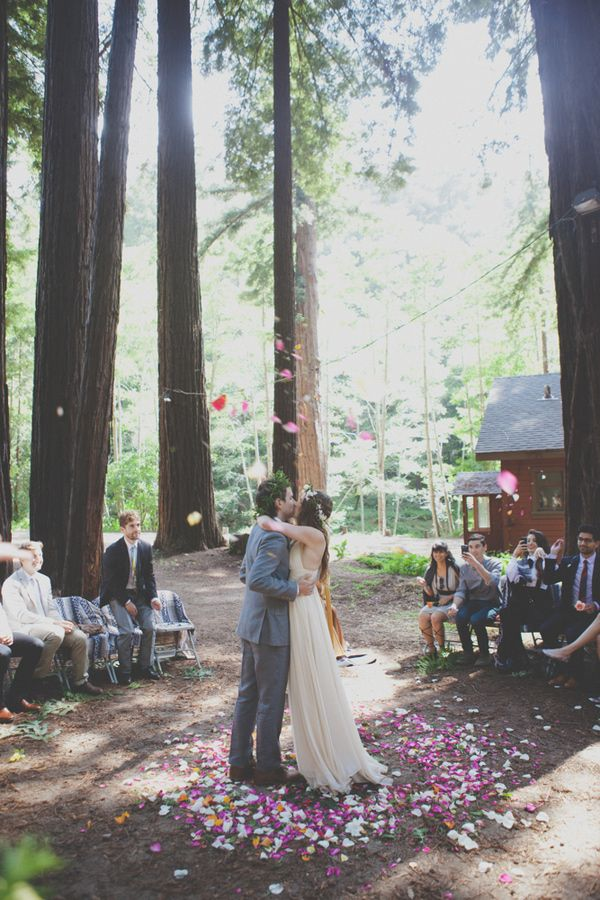 Beautiful wedding in the forest in Big Sur, California. The use of flower petals here is simple but stunning.